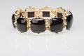Bracelet with black stones over white Royalty Free Stock Photo