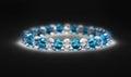 Bracelet with blue stones on black Royalty Free Stock Photo