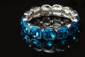 Bracelet with blue stones over black Royalty Free Stock Photo