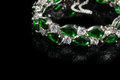 Bracelet with green stones isolated on black, close-up Royalty Free Stock Photo