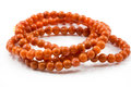 Bracelet orange d isolement sur le blanc Photographie stock