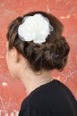 Braided and white flower teenage hairstyle with a background of an old building Royalty Free Stock Photos