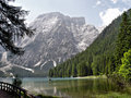 Braies lake the is a mountain and is located in the dolomites in south tyrol italy steep mountain slopes Stock Photos