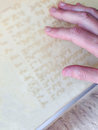 Braille information board a hand on a Royalty Free Stock Photo
