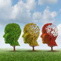 Brain aging and memory loss due to dementia and alzheimer disease with the medical icon of a group of color changing autumn fall Stock Images