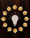 Brainstorm idea sign and circle made of cups of fresh espresso on table view from above Stock Image