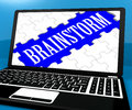 Brainstorm Puzzle On Notebook Showing Ideas For E-book Royalty Free Stock Photo