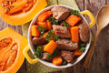 Braised beef with pumpkin closeup in the pan. Horizontal top vie Royalty Free Stock Photo