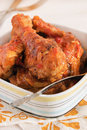 Braised chicken in tomato sauce in a bowl Royalty Free Stock Image