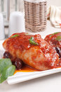 Braised chicken with tomato sauce and olives kalamata Stock Photo