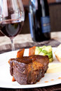 Braised Cumbrae's Short Rib served with Wine Royalty Free Stock Photo