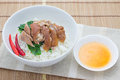 Braised pork with mei gan cai on plain rice thai style Stock Photo