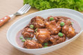 Braised pork ribs with green peas in bowl Royalty Free Stock Photo