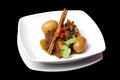 Braised pork selective focus of with egg in sweet soy sauce on black background Royalty Free Stock Photography