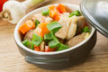 Braised pork with vegetables stew in a pot Stock Photos