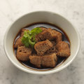 Braised puffed tofu traditional in soya sauce side dish in singapore and malaysia for bak kut teh pork rib soup Stock Image