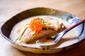Braised salmon with sake ans cream sauce fish eggs and Stock Photography