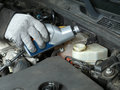 Brake fluid topping up auto mechanic in the vehicle Royalty Free Stock Photography
