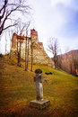 Bran castle dracula castle with cross tomb nearby in transylvania and wallachia romania Stock Photography