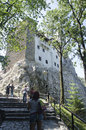 Bran castle romania surrounded by an aura of mystery and legend and perched high atop a foot high rock owes its fame to its Royalty Free Stock Photography