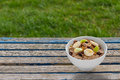 Bran flakes a bowl of on a weathered garden table copy space Stock Photography