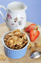 Bran flakes cereal in blue bowl Royalty Free Stock Photo
