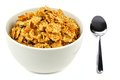 Bran flakes cereal bowl of and raisin on a white background with spoon Stock Photo