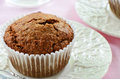 Bran muffin on pretty plate cream colored rippled in horizontal format Stock Photography