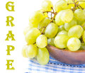 Branch of green fresh grapes in a wooden bowl on white for text Stock Image