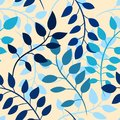 Seamless pattern with blue leaves on beige background