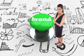 Brand against digitally generated green push button the word and thoughtful businesswoman Royalty Free Stock Photo