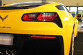 Brand new american sports car rear corner close up yellow chevy corvette c at auto show Stock Images