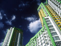 Brand new apartments fragment of modern condominium against a dark blue sky Royalty Free Stock Photo