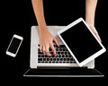 Brand new laptop tablet and smartphone woman hand holding working on Royalty Free Stock Photos