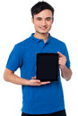 Brand new tablet device for sale handsome guy presenting Royalty Free Stock Image