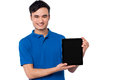 Brand new tablet device for sale young handsome guy presenting Royalty Free Stock Photography