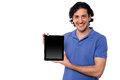 Brand new tablet device for sale young handsome guy presenting Stock Photos