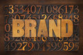 Brand word in wood type vintage letterpress against number background Stock Photos