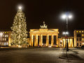 Brandenburger tor with a christmas tree in winter time Royalty Free Stock Photos