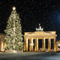 Brandenburger tor in december with a christmas tree and snowflakes Royalty Free Stock Photos