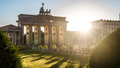 Brandenburger tor and sun at pariser platz in berlin sunlight Stock Photography