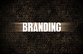 Branding in business as motivation in stone wall Royalty Free Stock Image
