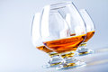Brandy or cognac in three glasses Stock Image