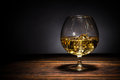 Brandy in glass with ice cube Royalty Free Stock Image