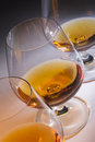 Brandy glasses cognac line of snifters with french Stock Photo