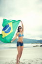 Brasil flag woman fan latino with laughing and smiling in support of brazilian soccer Royalty Free Stock Photography