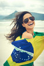 Brasil flag woman fan latino with laughing and smiling in support of brazilian soccer Stock Photography