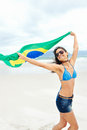 Brasil flag woman fan latino with laughing and smiling in support of brazilian soccer Stock Photo
