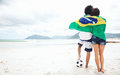 Brasil soccer fans brazil stand on beach together with flag for world cup with ball Stock Images