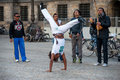 Brasilian man dancing capoeira dance on the amsterdam square with musicians guys editorial use only Stock Images